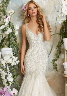 This elegant gown from Mori Lee is definitely a show stopper! The intricate crystal beading and the tulle mermaid skirt give this dress a modern, but romantic look! #morilee #weddinggown #miagracebridal