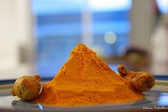 Turmeric powder and roots.    Turmeric is one of nature's most powerful healers.     http://biocurmin.blogspot.com/