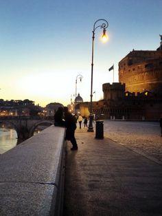 Stealing a sunset kiss on the Tiber #CastelSantAngelo #Roma
