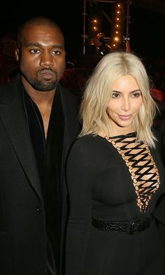 The two continued their Paris Fashion Week glamour tour coordinating their looks along the way. Kim belted her black body pantsuit contrasting her platinum blonde hair front row at the Givenchy show.