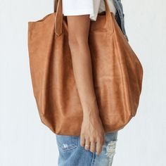 Our original hold-all tote bag. Made of the most luxurious and soft leather, Florence is slouchy and lush but will hold everything you need.Features one internal pocket and is unlined.Handle drop is 28cm35cm high, 44cm wide, 18cm deepDue to the handmade nature of our bags and leather being a natural textile, you may find small blemishes and that each bag differs slightly - this is unavoidable. We ensure that the quality of your bag will not be compromised.