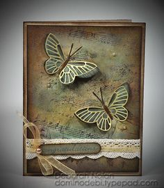 beautiful handmade card ... two Asian style butterflies on a hand stamped base ... subtle collage style background stamping with the look of an aged patina ... luv the elegant look of just enough gold sheen ...