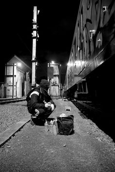 Photo of a graffiti artist admiring the freight train that is this vandals canvas with spray paint as his weapon of choice! #GetSome