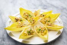 "Curried chicken salad spooned into endive ""boats"" for a crisp, delightful appetizer. ~ SimplyRecipes.com"