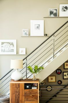 Artwork along the staircase - Loft Reveal: {Making Our Living Room Baby Friendly}