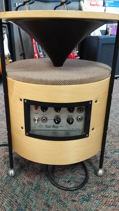 Unusual coffee table amplifier, all tube 10 watts. Sounds like a fender vibro champ, in mint condition,  powerful for only 10 watts looks like a piece of furniture, very interesting looking,  blends right into your living room, in perfect condition. $595 with free shipping in the continental USA