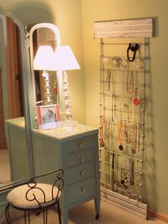 Recycle and old baby railing to organize your jewelry. Farm Girl Paints