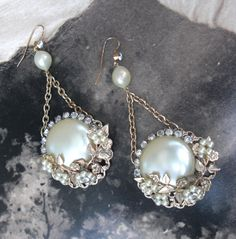 The Button Earring $110.00  Handmade, one-of-a-kind, re-purposed vintage jewelry.  Vintage 1950's button earrings surrounded by rhinestones and faux pearls