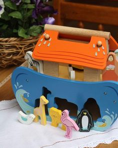 Noahs Ark Shape Sorter - Painted wooden shape sorter with 7 pairs of animals, slide, outside door, removable roof panels and carry handle, Noah and his wife that can also be shape sorted. Size wide x deep x high