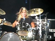 The rock band Skillet's drummer, Jen. Just more proof women are equal to men and kick ass!
