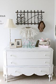Find curvy old dressers to paint white (or other fun color) as sofa tables with lamps on each end.