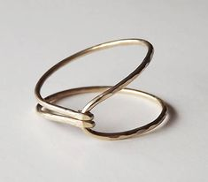 """Hammered Asymmetrical Gold Filled """"Hug"""" Ring – Gold Ring – Gold Band – Stacking Rings Hammered Asymmetrical Gold Filled Hug Ring by BellatrinaJewelry, via Etsy. Metal Jewelry, Jewelry Art, Jewelry Rings, Jewelery, Silver Jewelry, Jewelry Accessories, Jewelry Design, Bullet Jewelry, Stylish Jewelry"""
