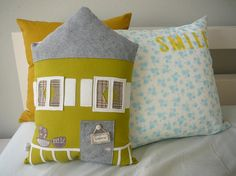 pillows.  This would be so cute to do a Christmas house pillow!