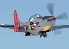 "a view of the P-51D Mustang called ""Tempus Fugit"", just after takeoff."