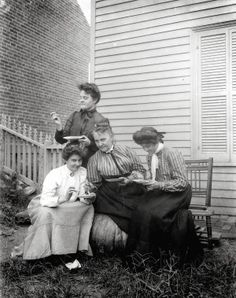 Group of four women eating outdoors. (1910) Missouri History Museum