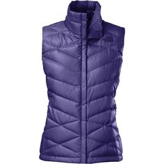 Perfect for transitional temps, this women's Aconcagua vest from The North Face® features a combination of 550-fill power goose down and warm Heatseeker® insulation. The iridescent fabric provides tons of style, while zippered pockets promise warmth for chilly hands or secure storage for small essentials.