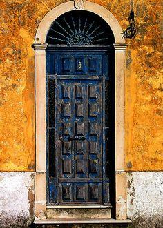 Portugal: Iron fanlight-house # above many raised panels. Great door surround too. Les Doors, Windows And Doors, Cool Doors, Unique Doors, Porches, Orange Door, When One Door Closes, Grand Entrance, Old Windows
