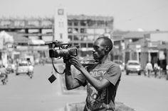journalist - cameraman - media - news - breaking news - shooting - black and white - people - man - working - filming