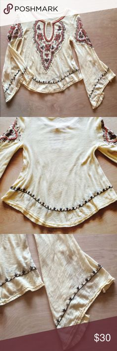 "•Free People• Boho Split Flare Bell Sleeve Top Free People Boho Split Flare Bell Sleeve Embroidered Keyhole Neck Peasant Top. Sublimely soft ultra lightweight vintage distressed cotton fabric and designed with pure bohemian styling. Intricate Boho Embroidery and frayed edging makes a statement. Scoop Button Keyhole Neckline and Log Split Bell Sleeves. Color: Maize; light yellow wig accents in sienna, sand and shades of brown and toffee. 200% Cotton. Armpit to Armpit Approximately 17"" Free…"