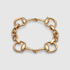 Gucci's iconic Horsebit bracelet in 18k yellow gold.