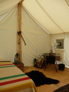 Heritage camping Canada Interior of canvas tents with Hudson's bay blanket