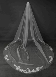 At about 56 inches down, this veil is adorned with beautifully beaded lace appliques. Each applique features silver lined bugle beads and shining rhinestones. The veil is 120 inches long. Ivory only. Bridal Veils And Headpieces, Bridal Gowns, Wedding Gowns, Cathedral Wedding Veils, Beaded Lace, Lace Applique, Bridal Accessories, Marie, Wedding Ideas