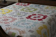 Camille Roskelley's of Thimble Blossoms, Puddle Jumping Quilt Pattern created with the Allison Harrison's fabric line, Wallflowers make a beautiful bedroom quilt.