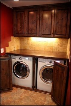 Love the counter space on top of the washer and dryer. Would choose a different wall and tile color but great space.