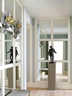MIRRORS ADD LIGHT AND DEPTH TH FOYER.