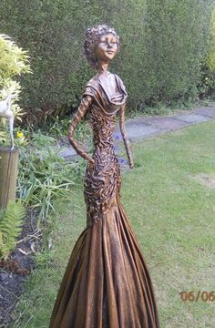 "by Sandra June Originals. Bronze lady sculpture about 40"" tall This gorgeous sculpture graces my own garden."