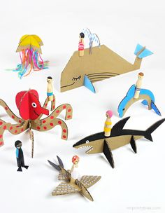 Make Summer Peg Dolls with Cardboard Sea Creatures  Make these fun sea creatures from cardboard and take your peg dollies on an ocean ride. here are 6 sea creatures – whale, dolphin, shark, octopus, jellyfish and flying fish. Print the template and cut some cardboard, you can create them by simply slotting the pieces – no glueing needed.