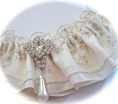 Ivory Rhapsody Bride Garter in Regal Beaded and Platinum Embroidered Lace Over Satin. $59.00, via Etsy.