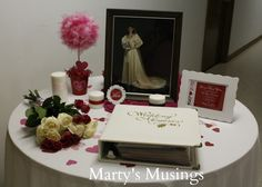 25th Wedding Anniversary idea- place original wedding picture and wedding album on table along with a current picture