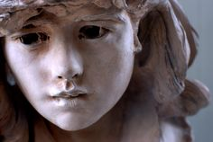 A stone sculpture of a young girl by Rodin