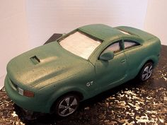 This Mustang Bullit car cake was commissioned by a beautiful young bride for her fanatical Mustang GT collecting groom. The cake ordered wa...