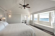 Vaulted bead board ceiling, perhaps a white fan? Dune Road Master Bedroom