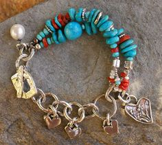 Harmony Bracelet Sleeping Beauty Turquoise interspersed with Mediterranean Red Coral, freshwater pearls and an almost round large bead of Nacozari Turquoise. Artisan handcrafted sterling silver. Toggle closure Bracelet length........7.0