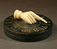 Whist marker, ebony base & bone hand, 1880-1910- This was the mechanical device that was used to keep score in the card game of Whist, popular in the 18th and 19th centuries. Whist evolved into the the modern game of Contract Bridge.