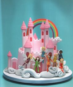 This cake is perfect for a Rainbow magic fairy party!
