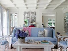 An East Hampton living rom with soft blues and whites. Design: Meg Braff
