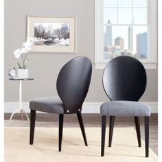 This set of two black and gray oval-back dining chairs by Safavieh is a chic accent to any modern room. The chairs feature a black rubberwood frame and gray upholstery, so they will match most room designs, and their polyester seat fill adds comfort.