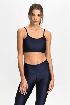 "Ensure a perfect fit and comfort all day with the The Everyday Sport Bra. Featuring a thin strap classic design and breathable mesh lining, this sport bra is perfect on its own with tights, or layered with your favourite workout tank top.  Our model is wearing a size Small. She usually takes a standard AU 8/Small, is 5'8"" (177 cm) tall, has a 84 cm bust, 89 cm hips and a 64 cm waist."