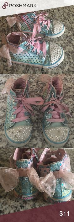 Sketchers Twinkle Toes shoes 🎀 Pink and baby blue adorable Twinkle Toes sneakers. Kid size 10. App. age 4/5 if that helps. Still lights up great but could definitely use a cleaning. A couple tiny flaws on the glitter part of the fronts. Nothing major. Still has plenty of life to them. Skechers Shoes Sneakers