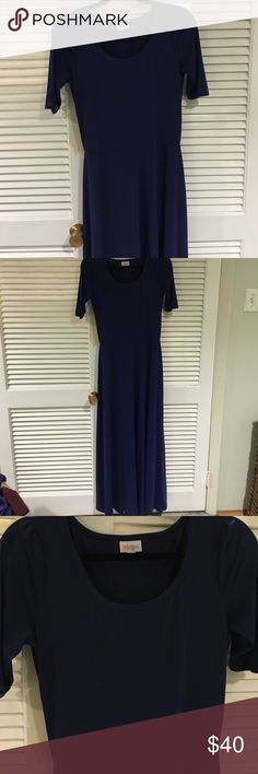 LulaRoe Ana Dress Navy Size Medium navy blue LulaRoe Ana dress. Worn once, just didn't like the way it fit me. 96% polyester, 4% cotton. Gorgeous navy color that can be dressed up or down! Perfect dress for summer time! Let me know if you have any questions! LuLaRoe Dresses Maxi