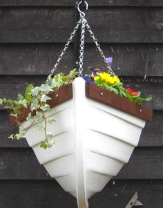 "boat planter for beach house or anywhere""- half a boat!"