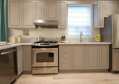 Painted cabinets, marble counters and new hardware - Income Property kitchen redo, HGTV