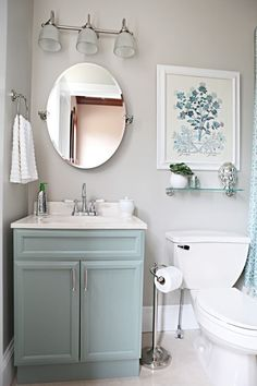 I love the cool gray color with the misty blue vanity. Crisp and clean look.