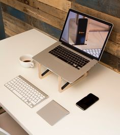 Plywood and silicone laptop stand. Designed and made in the U.K. Make a big improvement to your office ergonomics and use this portable wooden laptop riser for your MacBook (works with all laptops) and then pop out the inner sections and use as an iPad Pro stand (or a low rise support for any device). In stock now: £45 with free UK shipping - only from www.helmm.co