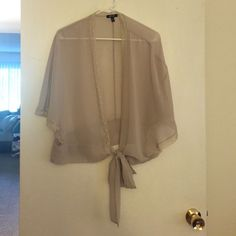 Chic sheer kimono coverup Very beautiful! A very light sheer material trimmed in lace. Color is hard to describe but is like a very light grey/khaki color. Ties about mid waist level. Worn once! Very cute for the office! Apt. 9 Tops Blouses