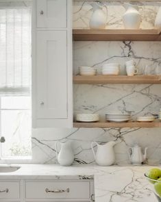 Stone slab counters & backsplash + floating wood shelves